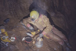 Simon Cawthan has a brew at underground camp (Photo: Dave Binks)